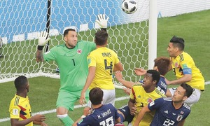 Early penalty helps Japan subdue Colombia 2-1