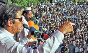 Imran takes poll drive to Islamabad