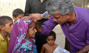 The Sindh candidate spotted handing out books to children has been identified!