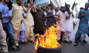 In pictures: PML-N workers protest court verdict against Nawaz, Maryam