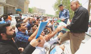 In Iraq, old grievances fuel deadly protests