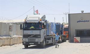 Israel reopens Gaza crossing as truce talks press on