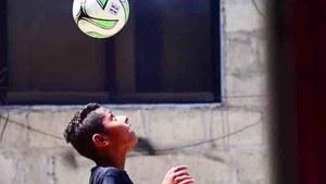 FC Barcelona coaches train Lyari's little football star Adeel Hanif