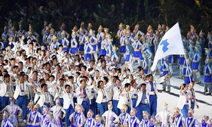 Two Koreas march together as Asian Games burst into life