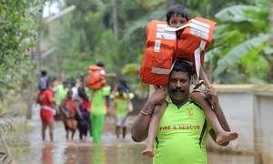 More bodies found in flooded Kerala as toll hits 357