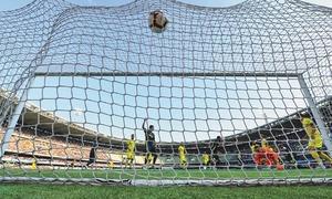 Ronaldo, Ancelotti make winning start in bruising Serie A