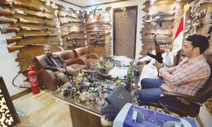 Baghdad gun shops thrive after rethink on arms control