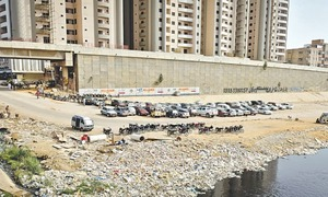 Supermarket given one month to shift parking lot from Lyari riverbed