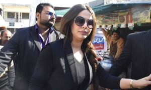 Customs court again issues bailable arrest warrants for Ayyan Ali in currency smuggling case