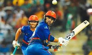 Rashid  blitz lifts Afghans in Asia Cup tie