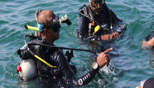 How a handful of certified divers have been removing litter from the Arabian Sea