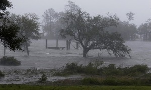 US hurricane leaves homes unmoored, power lines damaged