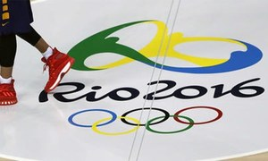 Ex-Kenyan Olympic chief surrenders to police