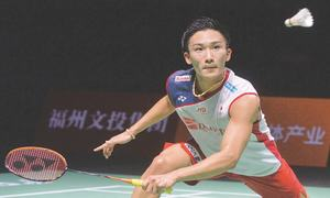 Momota battles into China Open final