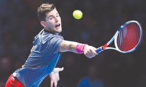 Federer downs Thiem to keep ATP Finals hopes alive