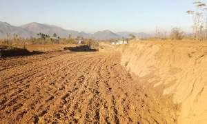 Landowners resume cultivation after delay in Dir road project