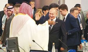 A high-five from Putin and an awkward photo: the high and the low for Saudi prince at G20 summit