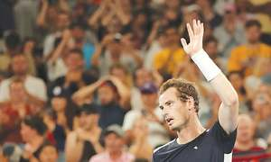 Battling Murray crashes out at first hurdle; Federer, Nadal fight on