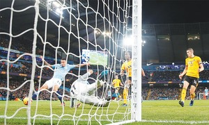 Jesus keeps up scoring spree as City ease past 10-man Wolves