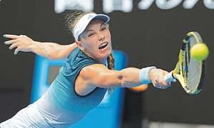 Sharapova stuns Wozniacki as Nadal, Federer plough on