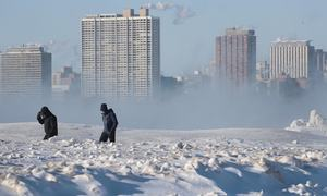 In pictures: Life slowly comes to a halt as polar vortex grips the midwest regions of the US