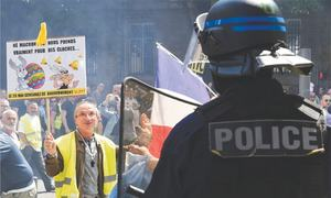 Yellow vest anger burns in France, fuelled by Notre Dame fire
