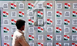 India's Congress urges workers to ignore ominous exit polls, be vigilant