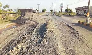 Bone-breaking journery on Daska-Sambrial Road goes on
