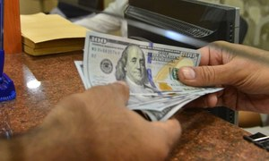 Dollar hits historical high at Rs157 in interbank market