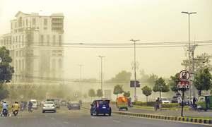 Dust storm, scattered rain break heat spell in Lahore