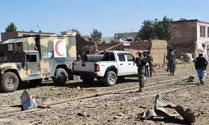 Taliban car bomb kills at least 14 as group holds peace talks in Qatar