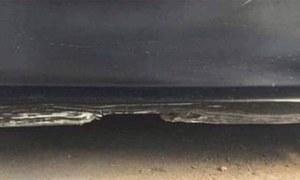 اس تصویر میں کیا ہے گاڑی کا دروازہ یا ساحل؟
