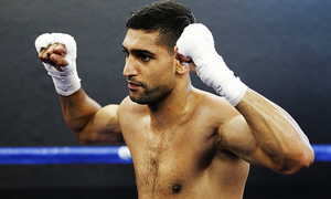 Amir Khan defeats Billy Dib to claim WBC international welterweight title