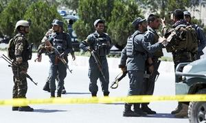 4 Afghan forces killed as Taliban attack hotel compound