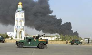 At least 12 killed in Taliban attack on Afghan police headquarters