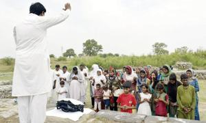 Christians perform rituals at Sirkap remains