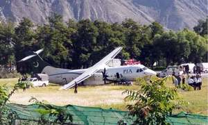 ATR team arrives to examine aircraft damaged while landing