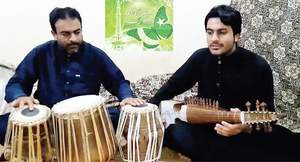 Tunes of national songs by father-son duo earn appreciation
