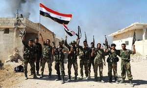 Syrian forces battle rebels for key town, highway