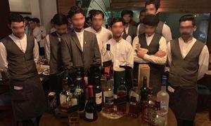 13 arrested, restaurant sealed in Lahore for allegedly serving alcoholic beverages