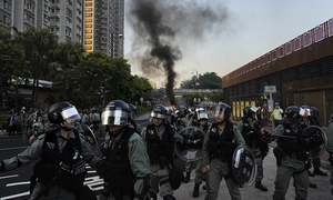 Police storm mall and Hong Kong protesters turn violent once again
