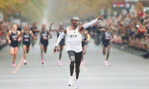Kipchoge first to dip under two hours for marathon