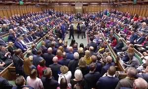 UK lawmakers vote to delay final Brexit decision again