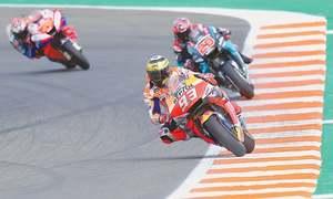Marquez triumphs in Valencia to give Honda triple crown