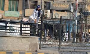 Shortage of crossings at Peshawar BRT pushes pedestrians to scale grills