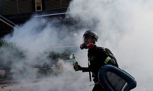 Hong Kong police threaten to use live bullets