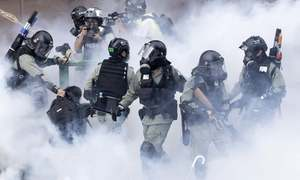 Hong Kong police battle protesters trying to escape arrest
