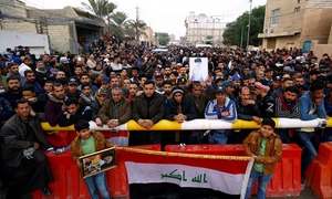 Tensions flare as gunmen kill 17 protesters in Baghdad