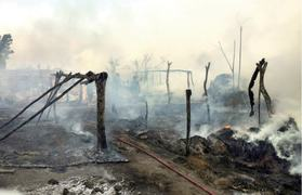 Fire destroys more than 10 huts