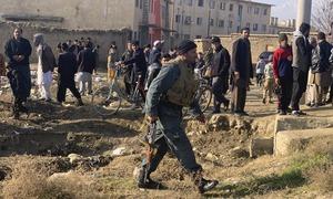 Taliban bombers target key US Afghanistan base as talks resume